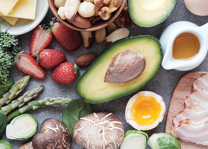 Typical ingredients on a Keto diet including, fruits, vegetables, meat, and nuts