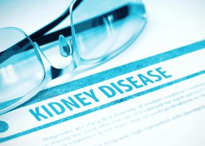 "A pair of glasses on a document with the heading ""KIDNEY DISEASE"""
