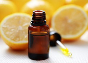 bottle-of-lemon-essential-oil-with-lemon-halves