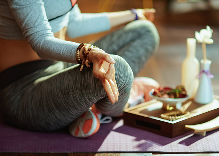 close-up-on-woman-in-fitness-clothes-meditating