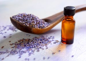 dried-lavender-with-a-bottle-of-essential-oil-on-a-rustic-table