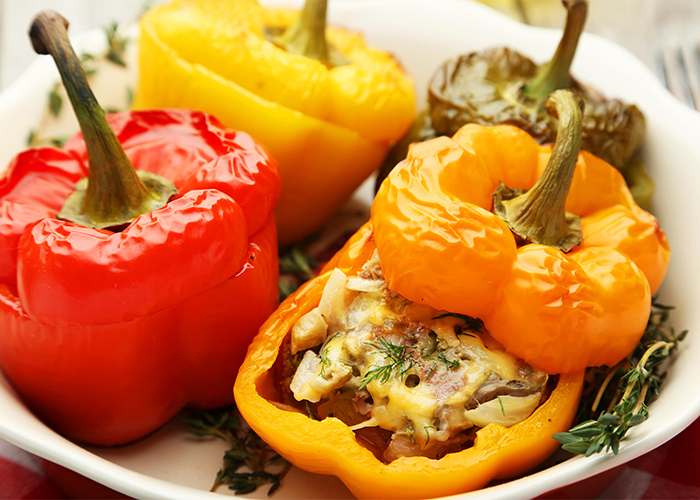 red-and-yellow-stuffed-peppers-in-a-white-bowl