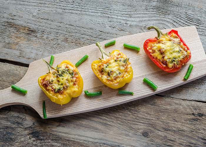 stuffed-peppers-with-meat-on-a-wooden-board